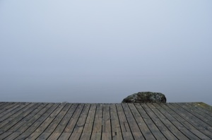 dock, mist rising from water, wooden plank, muffled