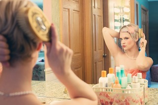 100 words about a woman who doesn't listen to the magic mirror