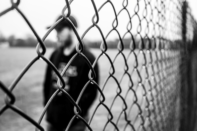 three line tales week 58: a man behind a fence