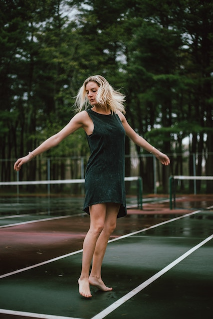 three line tales week 76: a woman dancing on a tennis court