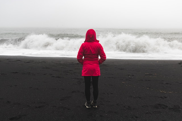 three line tales week94: little red riding hood, a girl in a red parka on a beach