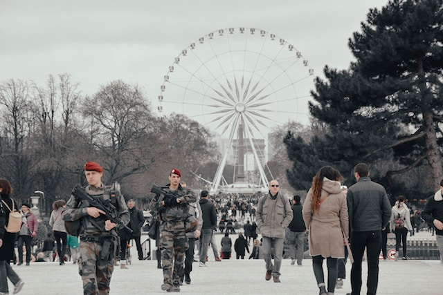 three line tales, week 100: a ferris wheel in Paris with soldiers patrolling