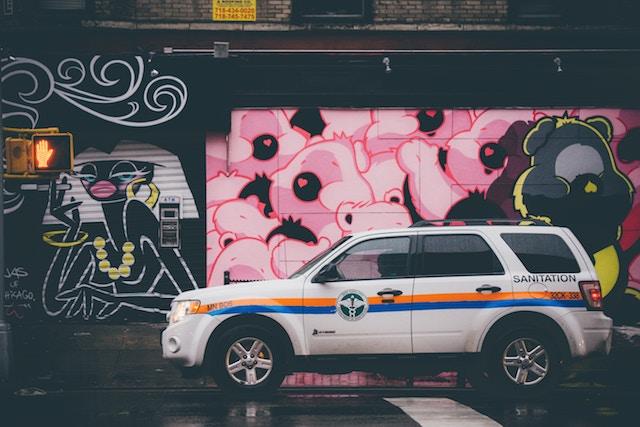 three line tales week 103: a sanitation van in front of pink graffiti