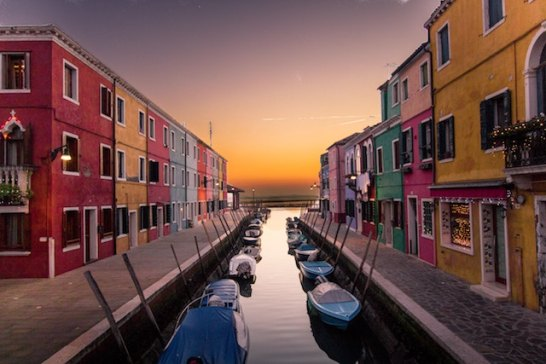 three line tales, week 122: a canal, boats and colourful houses