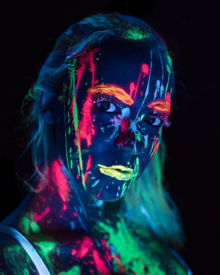 three line tales, week 141: a face covered in neon-coloured splatters