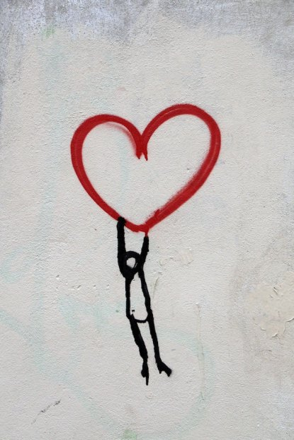 three line tales, week 159: a little fellow dangling from a graffiti heart