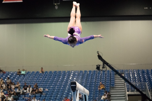 three line tales, week 161: a gymnast in mid-flight
