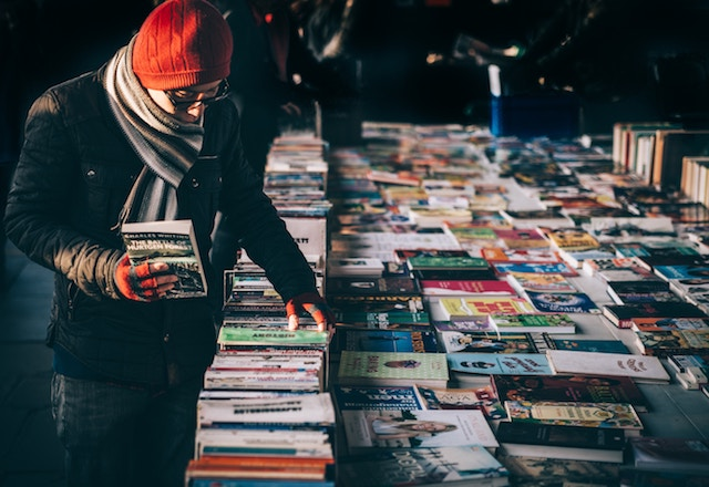 three line tales, week 162: people browsing a book stall