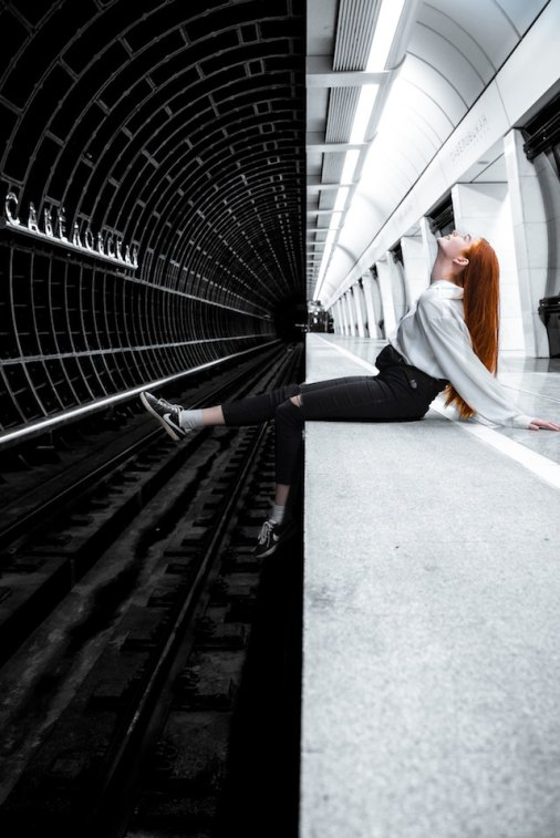 three line tales, week 201: a woman sitting on a Moscow subway platform