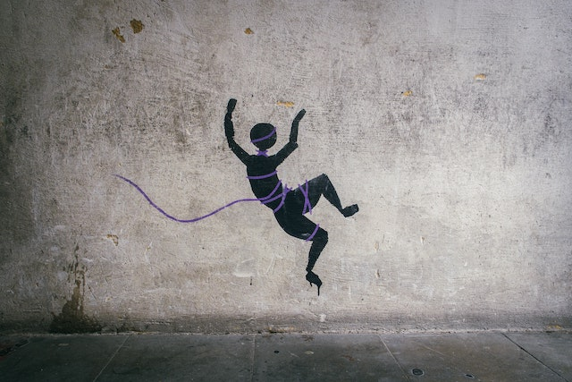 three line tales, week 227: graffiti of a human falling