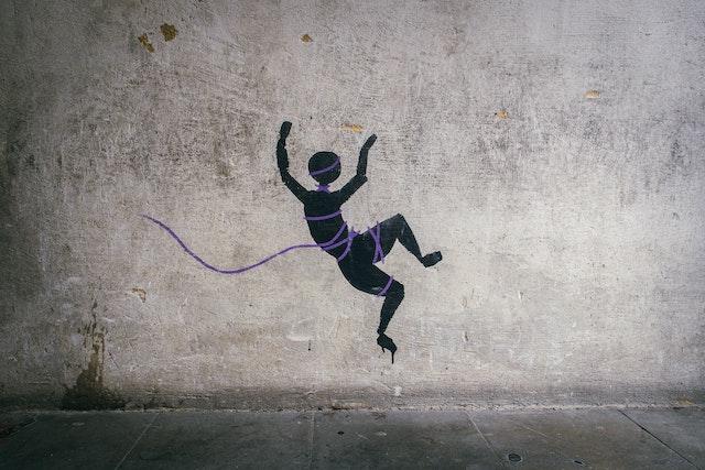 three line tales, week 227: graffiti of a human falling