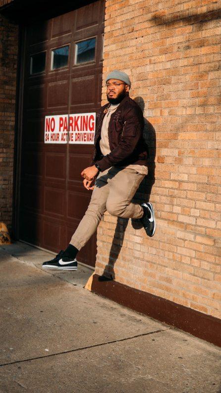 three line tales, week 228: a man floating against a wall in Brooklyn