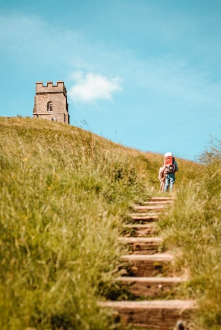 three line tales, week 229: someone trekking up the steps to the tower on top of Glastonbury Tor