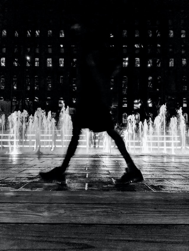 three line tales, week 45: a black silhouette in front of a fountain at night