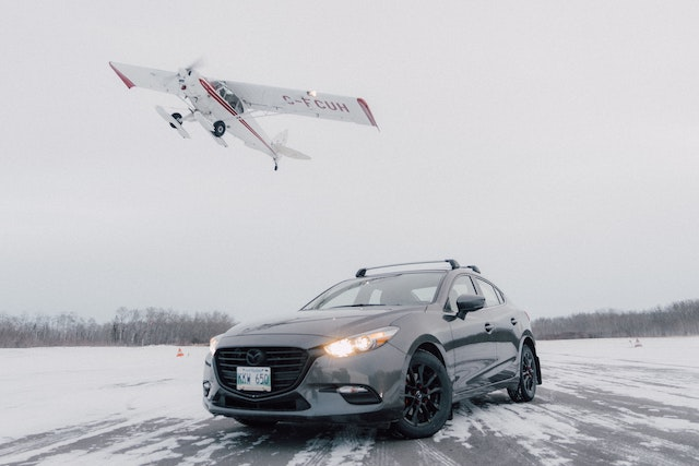 three line tales, week 266: a plane taking off with a car on the snowy runway