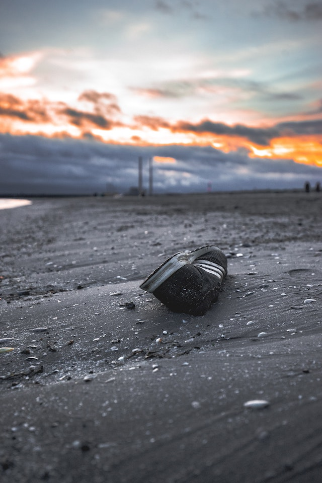 three line tales, week 267: an abandoned trainer on Bull Island with the Poolbeg chimneys in the distance