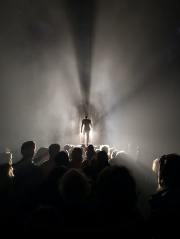 three line tales, week 269: a man standing on a stage with an audience