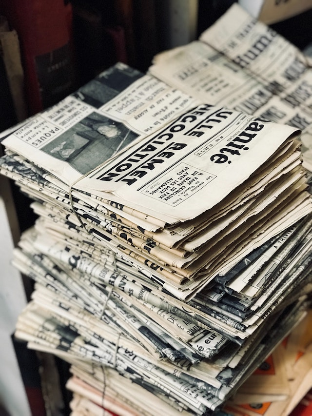 three line tales, week 274: a stack of newspapers